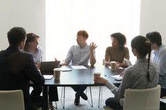 Diverse employees negotiate brainstorming in conference room stock photos