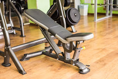 Diverse equipment and machines at the gym room Stock Photography