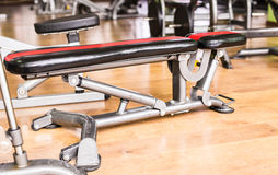 Diverse equipment and machines at the gym room Stock Photo
