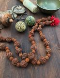 Diverse ethnic objects for meditation and relaxation: singing bowl, strike plates, drums, beads and two balls Royalty Free Stock Image