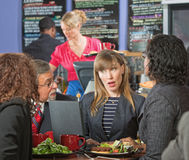 Diverse Executives Meeting in Cafe Stock Images