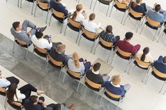 Diverse executives sat in conference room. Overhead view of diverse executives sat in conference room royalty free stock photo