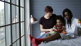 Diverse family with son relaxing together at home stock footage