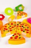 Diverse fausse nourriture en tant que jouets sur le fond blanc Image libre de droits