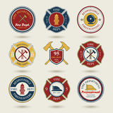 Diverse fire department emblems set Royalty Free Stock Photos