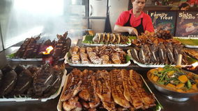 Diverse food at a philippine market. stock footage