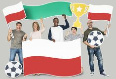 Diverse football fans holding the flag of Poland Stock Photo