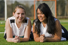 Diverse Friends. Two High school seniors girl friends posing for a sports photo Royalty Free Stock Photo