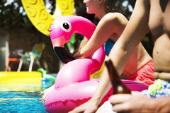 Diverse friends enjoying summer time by the pool Royalty Free Stock Images
