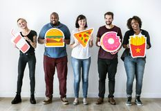 Diverse friends with food icons Stock Photos