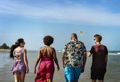 Diverse friends having fun at the beach royalty free stock photos