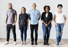 Diverse friends standing together casual clothing stock images