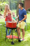 Diverse friends talking on barbecue stock photos