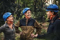 Diverse friends trekking in the forest royalty free stock photography
