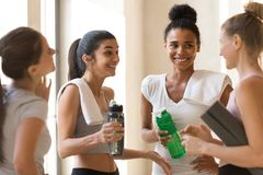 Diverse friends young females talking after workout stock images