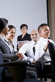 Diverse group businesspeople watching presentation Royalty Free Stock Photo