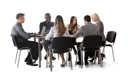 Diverse Group Of Businesspeople Working On Laptop stock image