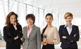 Diverse group of businesswomen at office. Diverse group of businesswomen of different ethnicity and age at office royalty free stock photos