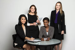 Diverse group of businesswomen working as a team stock photos