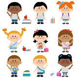 Diverse group of children students. A happy multi ethnic group of children students wearing uniforms, carrying backpacks, school bags and books Royalty Free Stock Images