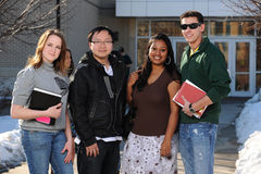 Diverse group of college students. In School campus holding their books Stock Photos