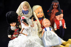 Diverse group of dolls. Group of antique dolls on black background Royalty Free Stock Image