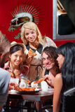 Diverse Group Eating Pizza Outside Stock Images