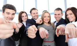 Diverse group of executives all pointing at you. Happy diverse group of executives all pointing at you Royalty Free Stock Images