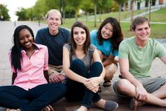 Diverse group of friends. Outside smiling together royalty free stock image