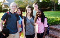 Diverse group of friends. Walking and smiling Royalty Free Stock Photo