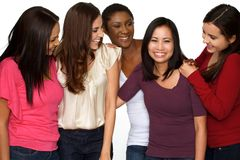 Diverse group of women laughing and talking. Diverse group of happy women laughing and talking isolated on a white background stock photos