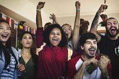 Diverse group of friends watching sports game together royalty free stock image