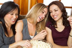 Girlfriends laughing and hanging out. Stock Photo