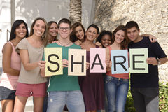 Diverse group holding sign with letters Share Royalty Free Stock Photos