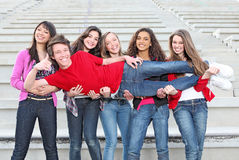 Diverse group kids. Diverse group of teens, teenagers youth kids having fun stock images