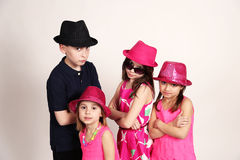 Diverse group of kids playing dress up Royalty Free Stock Photo