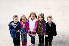 Diverse group of little kids outside Stock Images