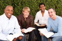 Diverse group of men studying together. Royalty Free Stock Photography