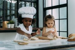 Free Diverse Group Of African American And Caucasian Girls Prepare The Dough And Bake Cookies In The Kitchen Royalty Free Stock Photography - 188008897