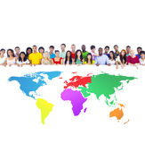 Diverse Group of People with Colourful World Map Stock Photo
