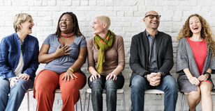 Diverse Group of People Community Togetherness Sitting Concept stock photos