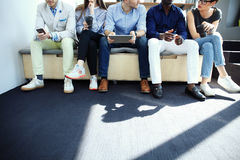 Diverse Group of People Community Togetherness Technology Sitting Concept. stock images