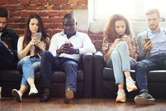 Diverse Group of People Community Togetherness Technology Sitting Concept. Royalty Free Stock Photos