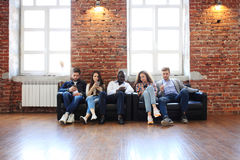 Diverse Group of People Community Togetherness Technology Sitting Concept. Royalty Free Stock Photography