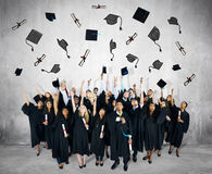 Diverse Group of People and Graduation Concepts Stock Photos