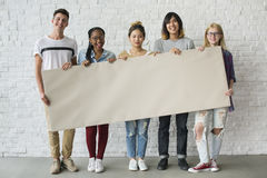 Diverse Group of People holding Blank Card. Friends Standing Together Holding Blank Placard Royalty Free Stock Images