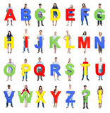 Diverse Group of People Holding the Letter A-Z Royalty Free Stock Photography
