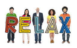 Diverse Group of People Holding Text Relax Stock Image