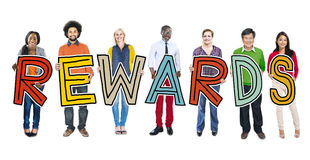 Diverse Group of People Holding Text Rewards Concept royalty free stock photo