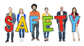 Diverse Group of People Holding Text Safety royalty free stock images
